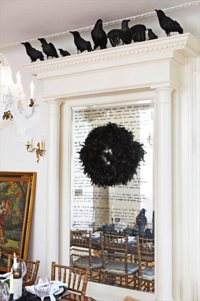 Mirror With Crow And Wreath Design Idea