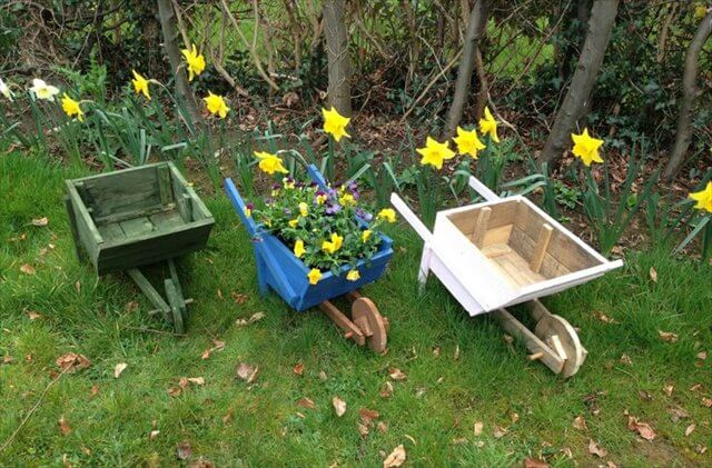 Hand made from pallet wood, rustic wheel barrow planters
