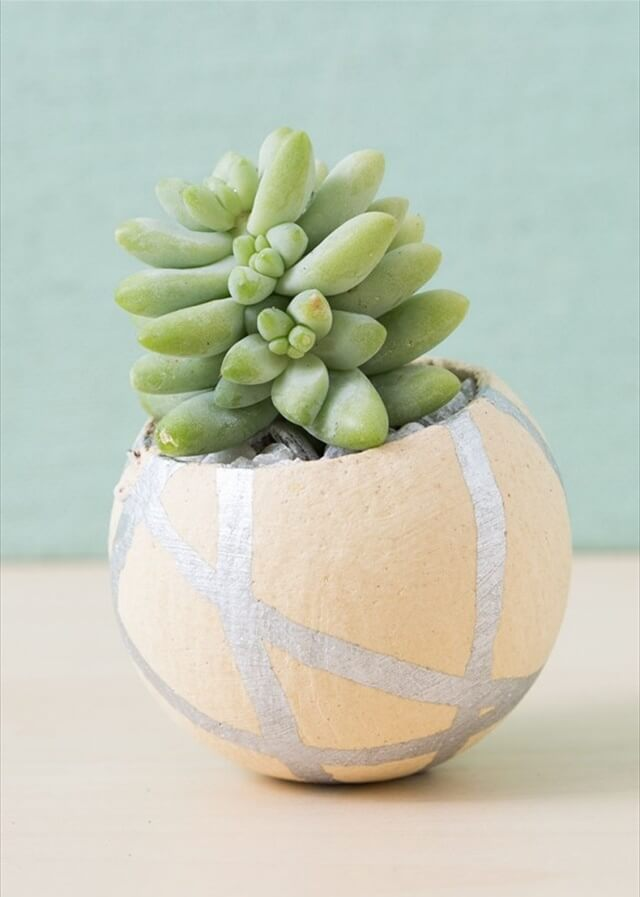 A silver paint pen makes this bell cup planter look so cute