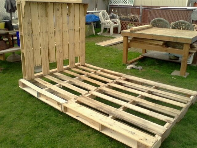 Bed Frame and headboard made from Pallets. The frame has hinges in the middle on