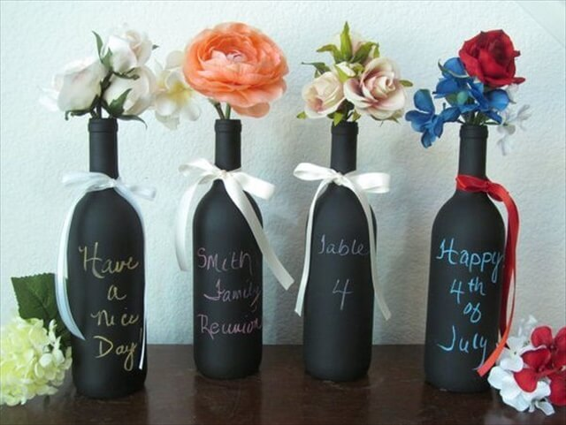 Chalkboard wine bottle vases are not only great for writing table numbers on. If you decide to pain the entire bottle then you can write on it longer messages and even draw something on