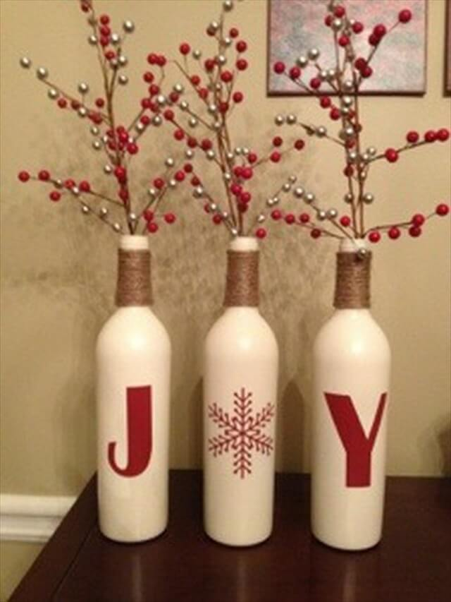 This is a stunning idea, perfect for winter weddings. These are wine bottles that look like they have snow on them. Apply a coat of primer, let it dry and then spray the bottles with adhesive and roll them in Epsom salt