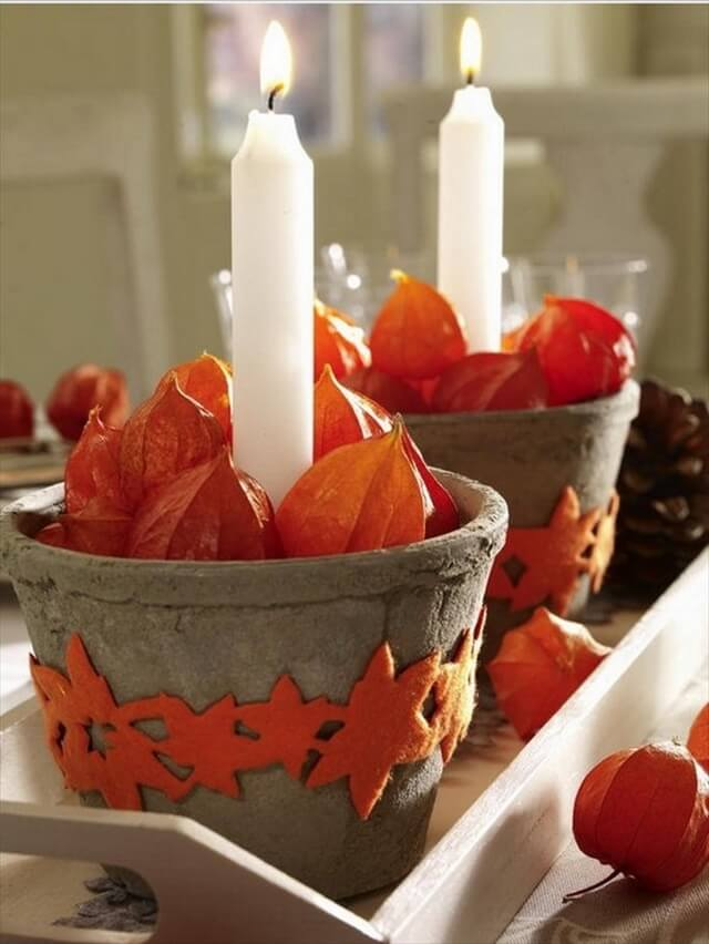 The idea of placing candles in small terra cotta pots is charming and effective