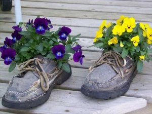 Recycling shoes for planters and backyard decorating with flowers