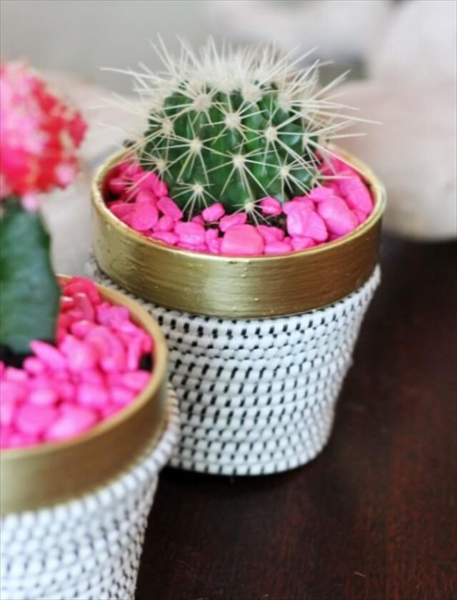 DIY succulent plant in terracotta pot wrapped in rope with hot pink aquarium rocks