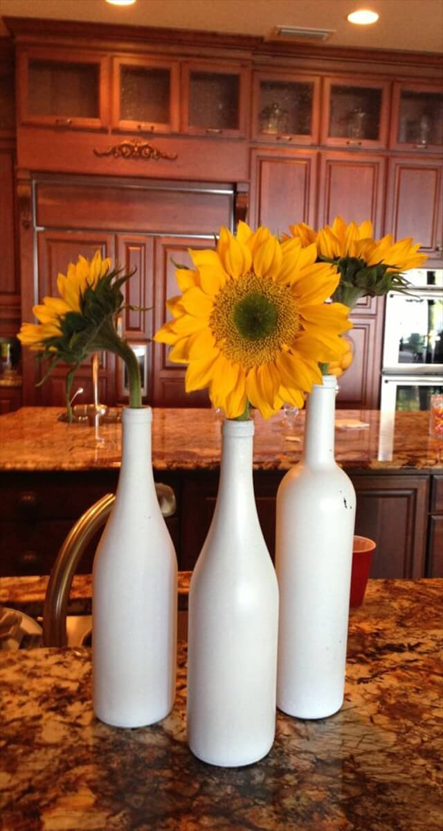 28 diy stunning wine bottle centerpiece diy to make for Painted wine bottle wedding centerpieces