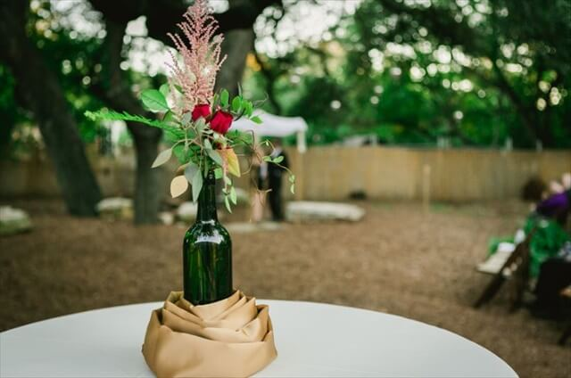 28 diy stunning wine bottle centerpiece diy to make for Wedding table decorations with wine bottles