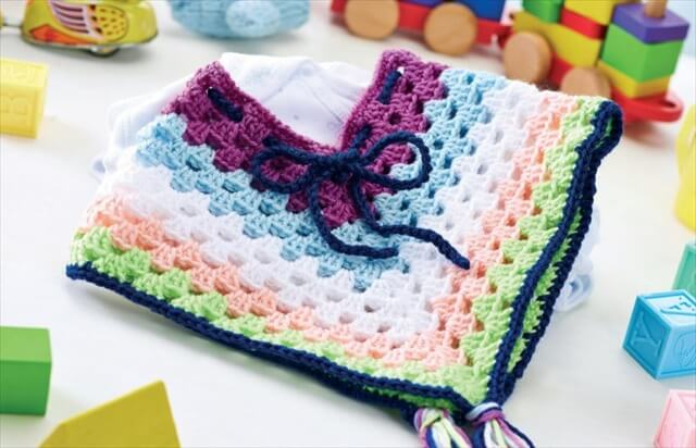 Cheerful crochet baby poncho