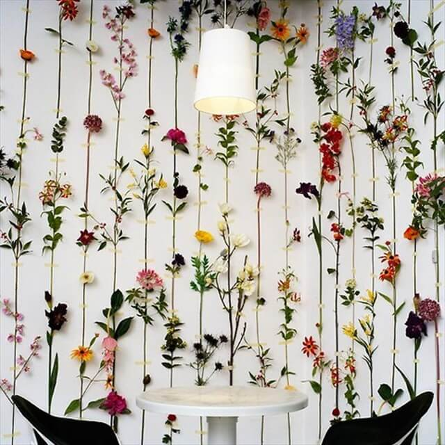 Transform dried flowers into gorgeous wall decor. could also use homemade paper flowers