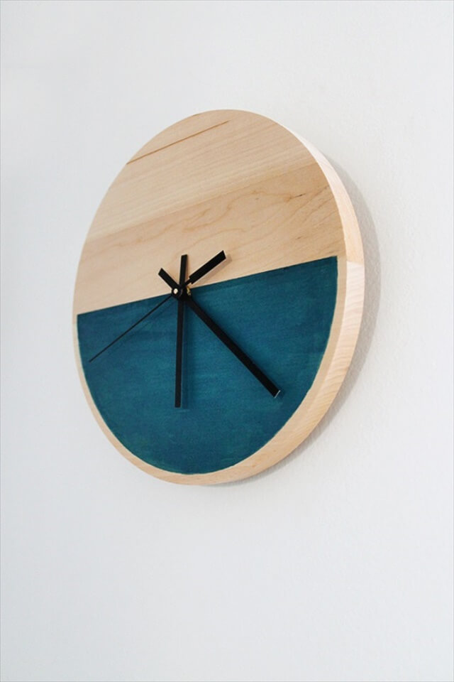 Minimalist Wooden Clock: It's clean, modern and, best of all, color blocked! We are thinking maybe a shade of Pantone's Radiant Orchid would be a sweet color to try.