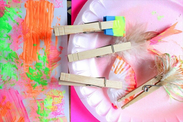 fun is this idea for using clothespin to hold all sorts of cool items for painting