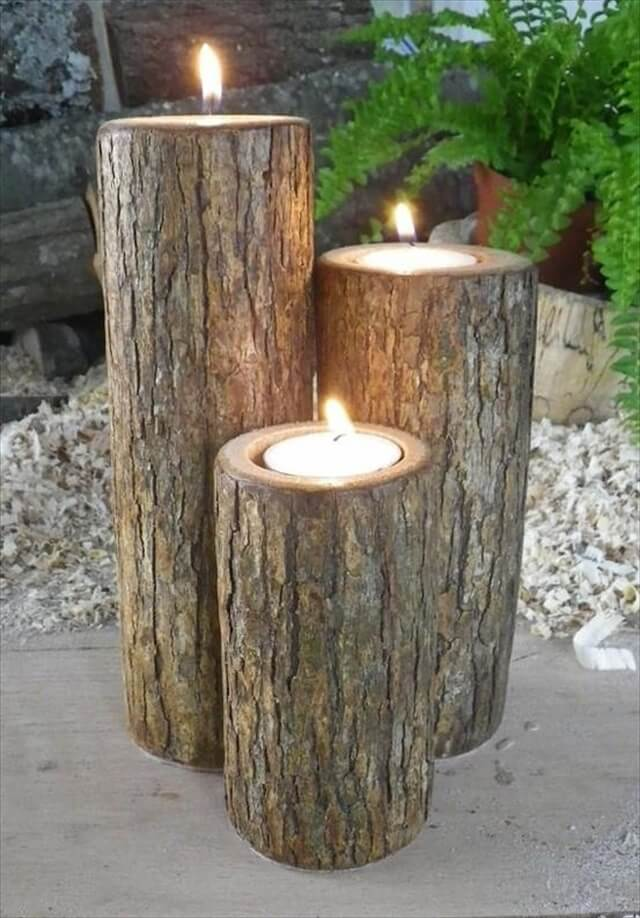 Homemade candles carved into wooden blocks