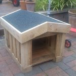 A Small Dog Kennel Out Of Pallets