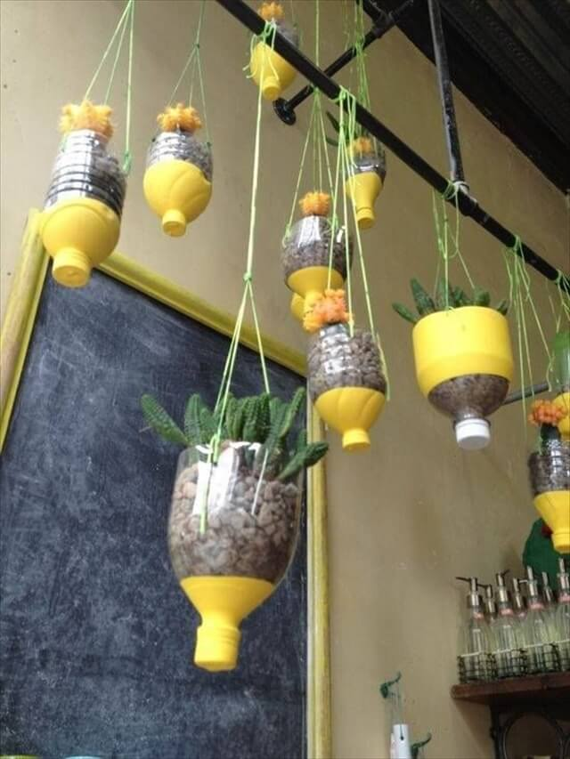 Hanging bottle planters- now these are cute plastic bottle planters!