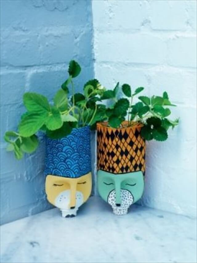 16 recycled bottle planters diy to make for Diy plastic bottle