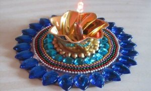 recycle old CDs into beautiful candle holder