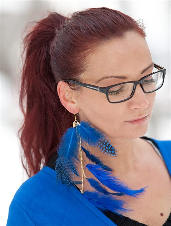 Blue feather and gold chain earrings