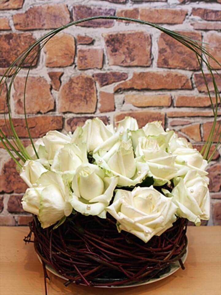 diy wedding flower arrangement white roses pearls sticks nest