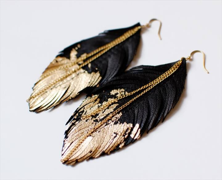 Black leather dipped in gold earrings