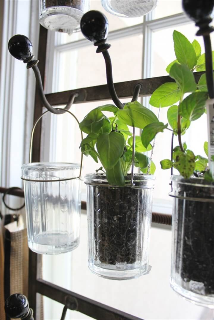 easy DIY where all you need are hooks and some hanging glass jars for your herbs.