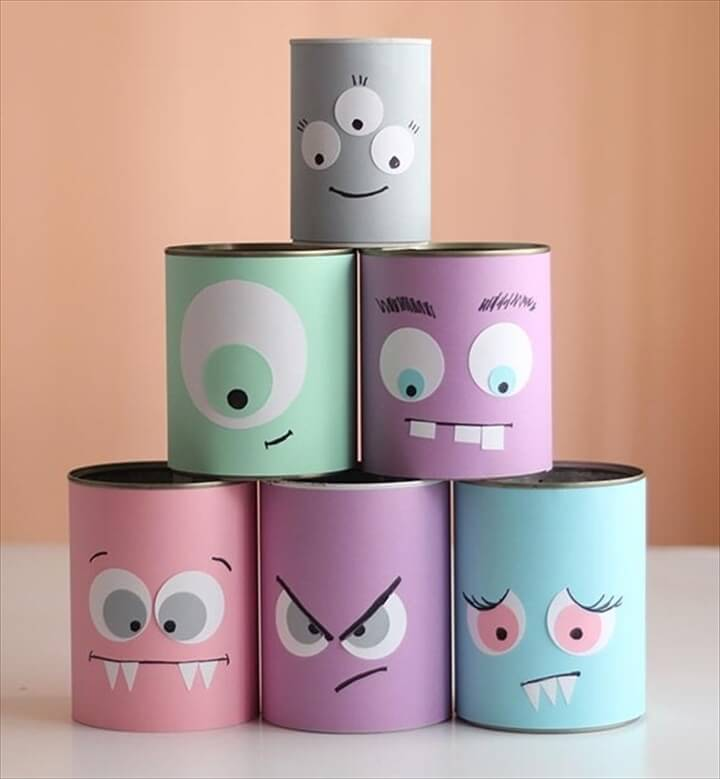 reused old tin cans as halloween crafts for kids with funny decoration