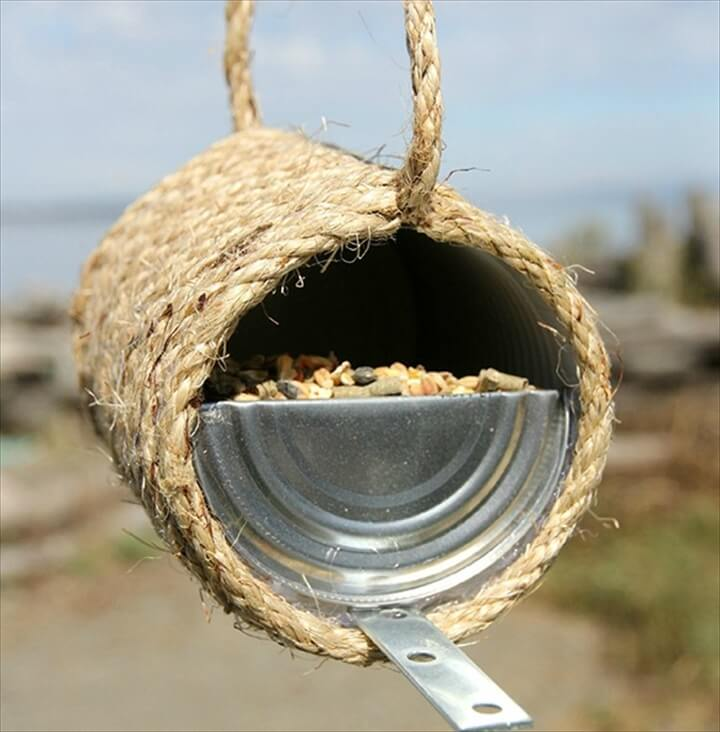 A nice tin can & sisal bird feeder idea