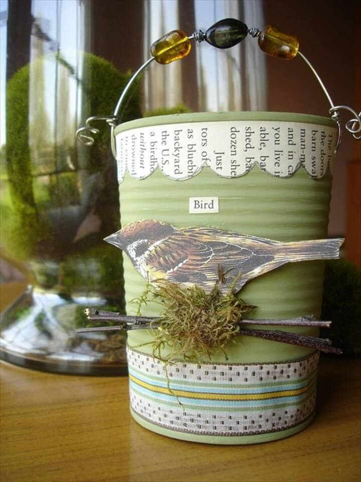 Use a recycled can, paint layers of different acrylic paint and embellished with ribbon