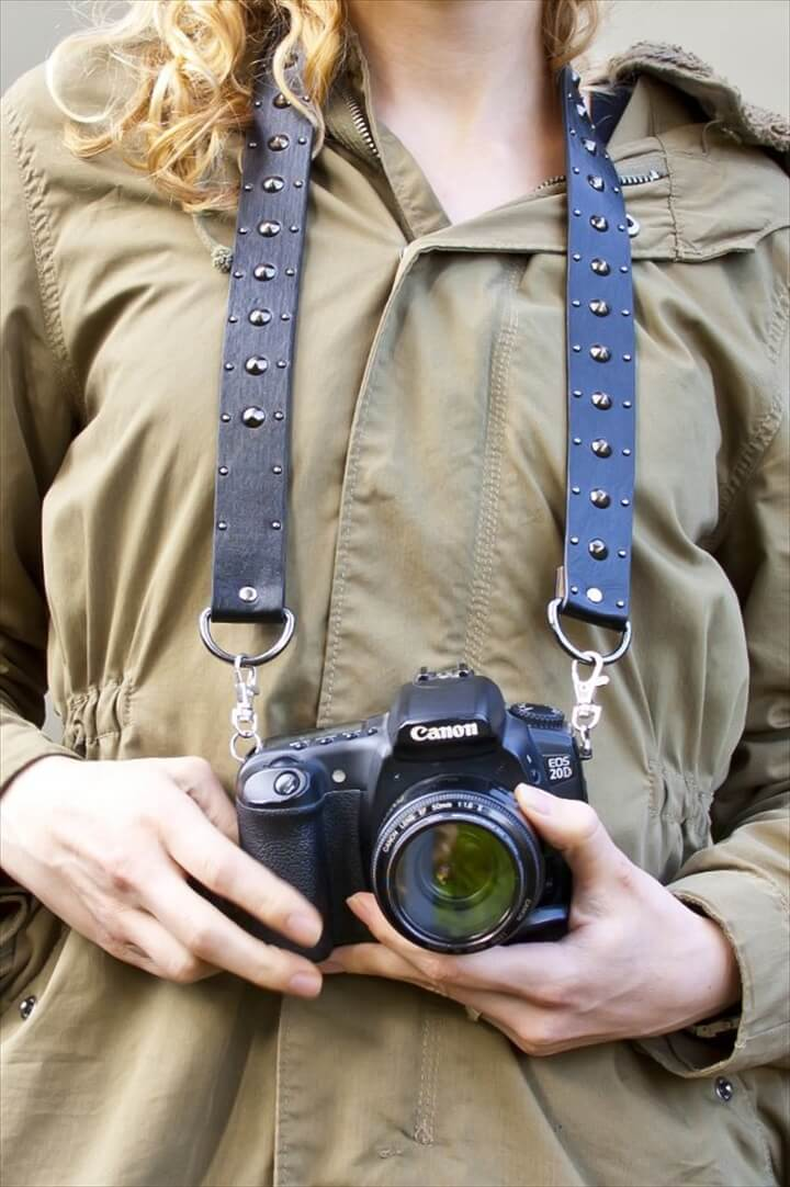 Convert an old belt into a camera strap.