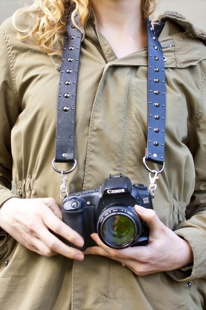 Convert an old belt into a camera strap.