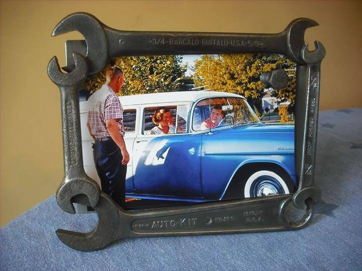 old wrenches made into a picture frame, with a magnetic bolt.