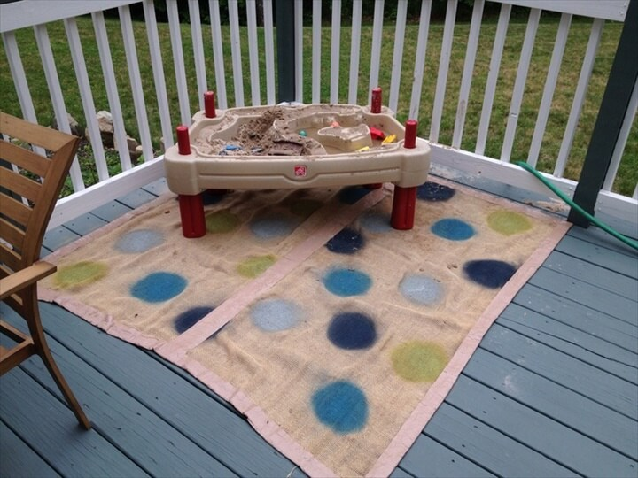 Burlap, duct tape & spray paint. Outdoor rug for the play area