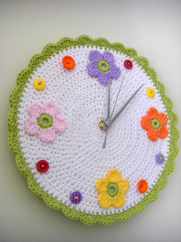 This crochet wall clock with flowers and buttons is the most creative thing