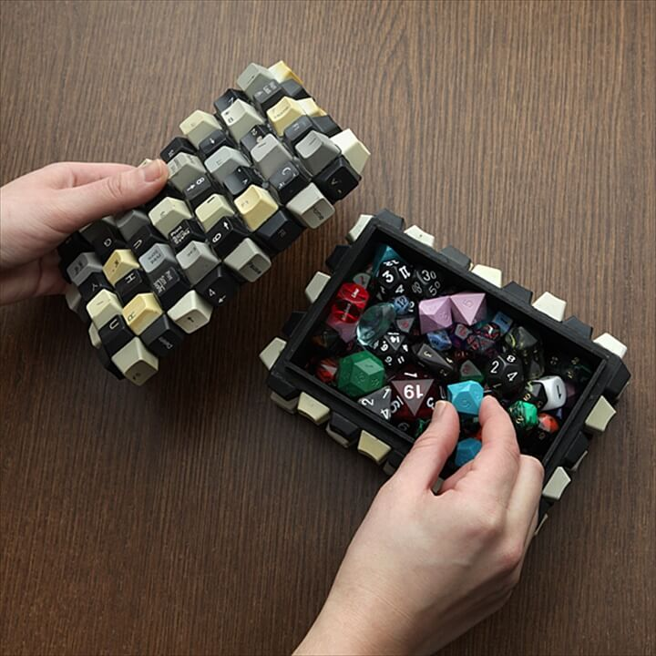 Wooden boxes covered with upcycled keyboard keys