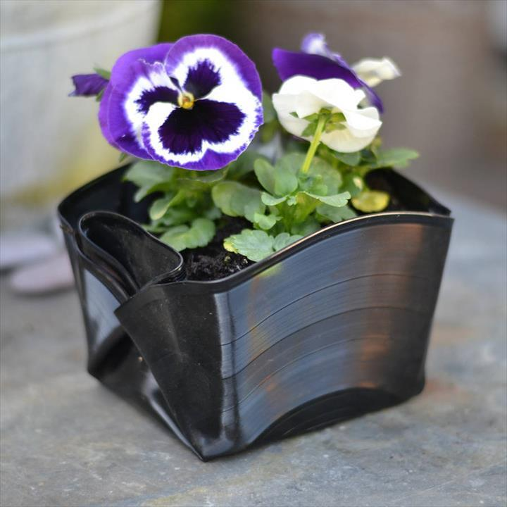 folded vinyl record plant pot