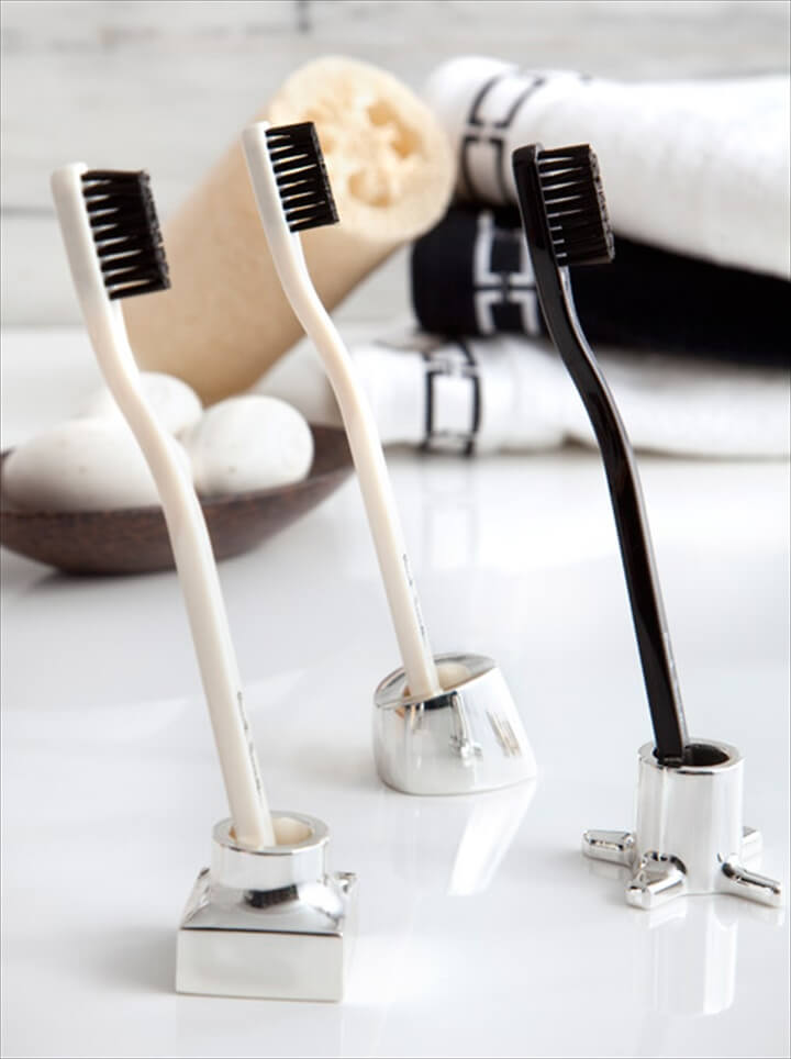 Silver toothbrush/razor holders
