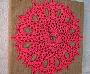Candy pink flowery crocheted wall clock on burlap board idea: