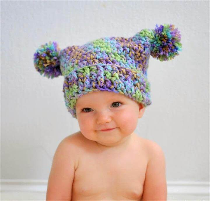 crochet pattern to make this adorable double pom pom hat!