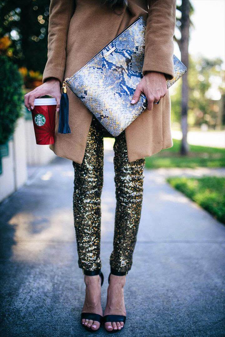 cool girl new year's eve outfit ideas - python clutch, camel coat + gold