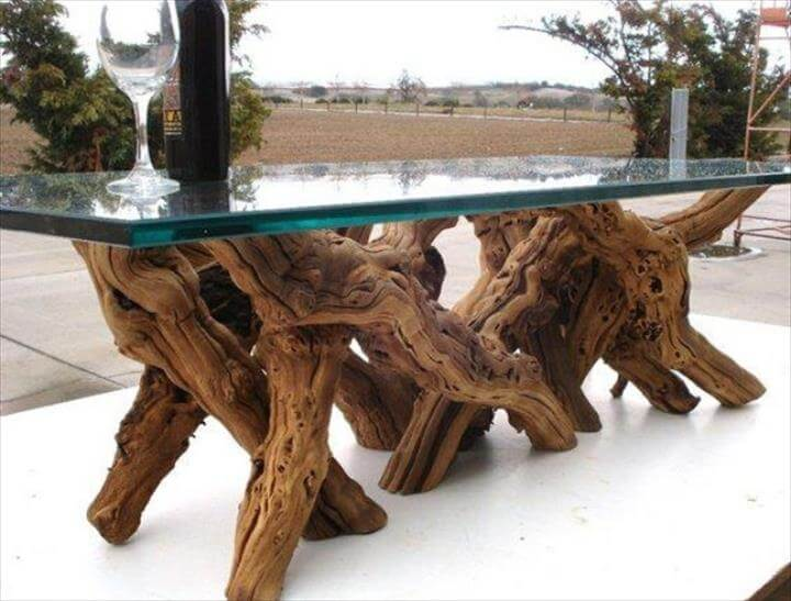 Tree trunk table with glass top