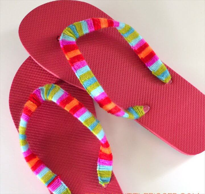Wrap a pair of flip flop straps with yarn.
