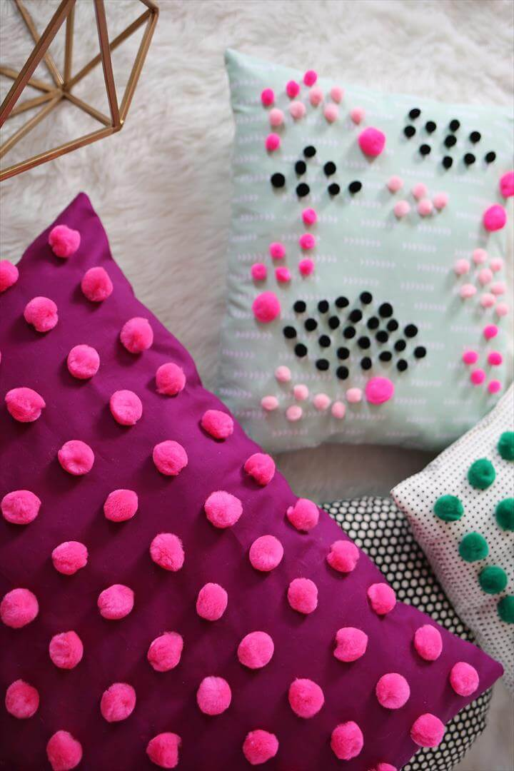 Add pom poms to your pillows for a textured effect