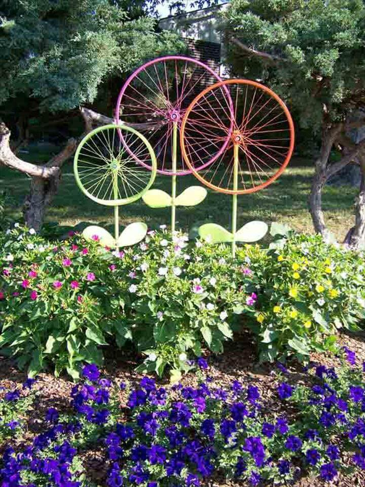 Bicycle Wheel Garden Art - recycle those bicycle tire frames painted in the color of your