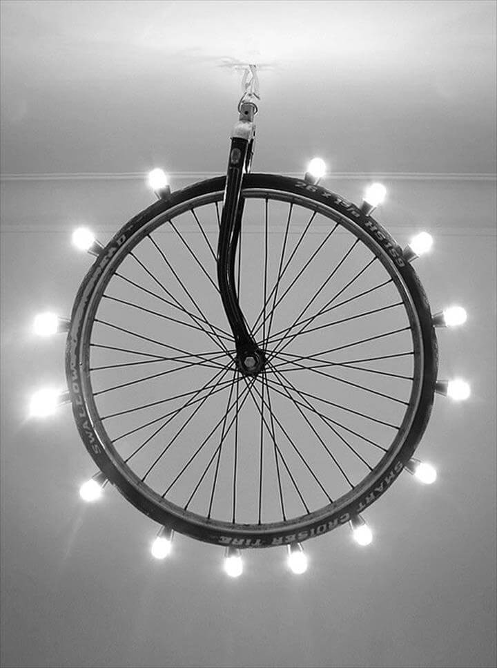 Many people do not believe that Bicycle Wheels can be reused in effective manner. Well, for those people we have come up with this awesome idea of fixing the Bicycle Wheel on the wall. You can put as many pictures as you can.
