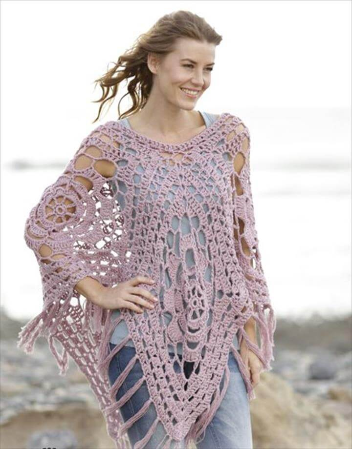 Crochet DROPS poncho with lace pattern in squares