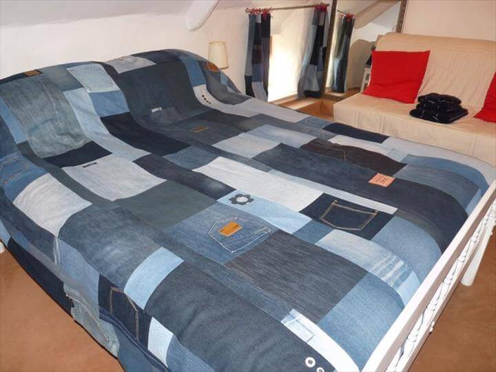Denim jeans patchwork bedspread throw blanket quilt. Embellished with jeans tags, buttons, belt