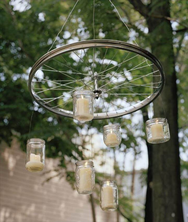 Bicycle Wheel. Hang glass jars with candles inside from a