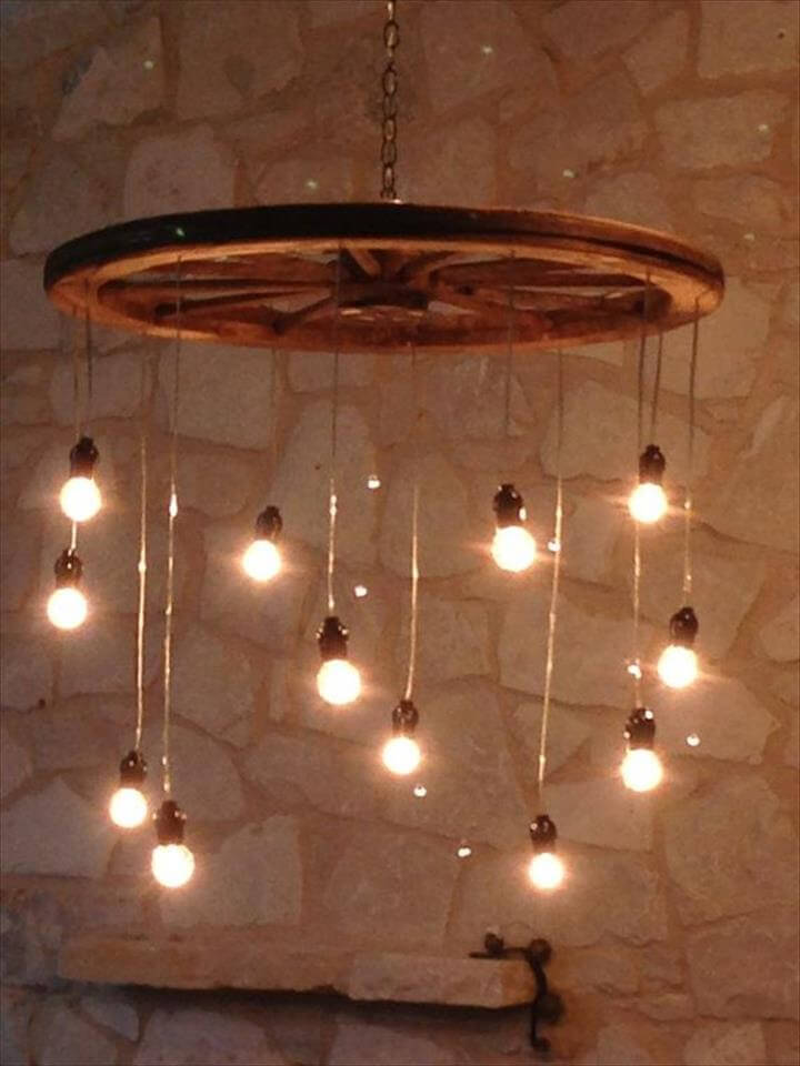 Idea for lighting to build: wagon wheel, pendant globe lights, chain. Random