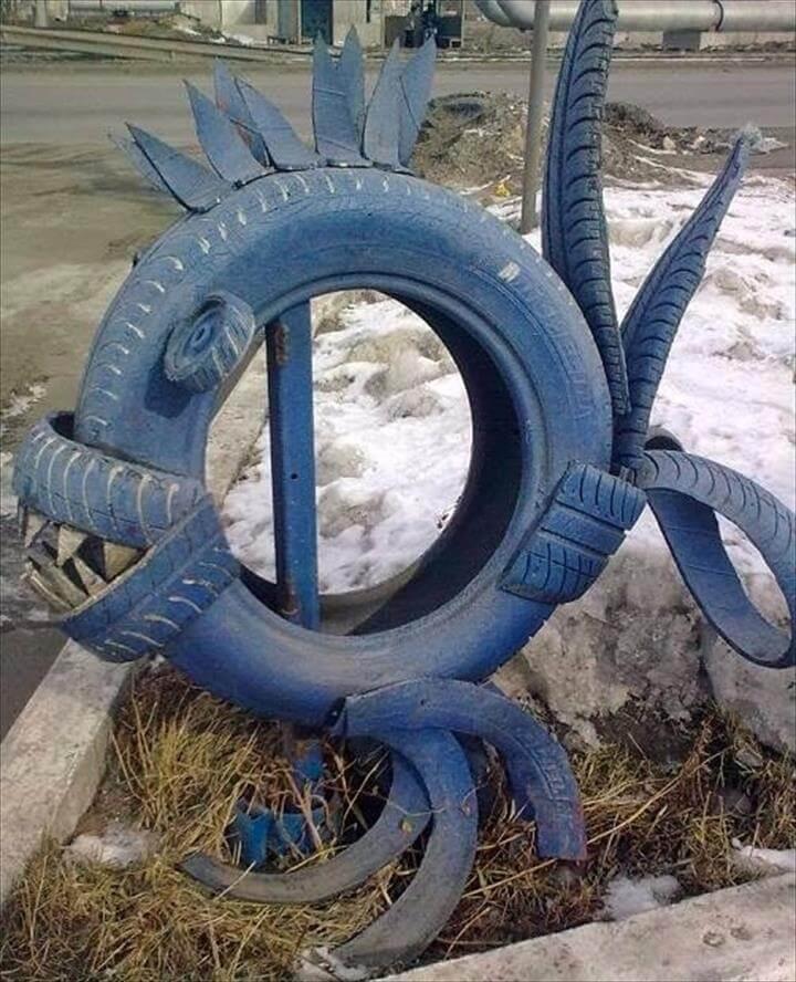 Tire recycling ideas creative old tire recycling blue predatory fish garden idea diy repurposing cut tires