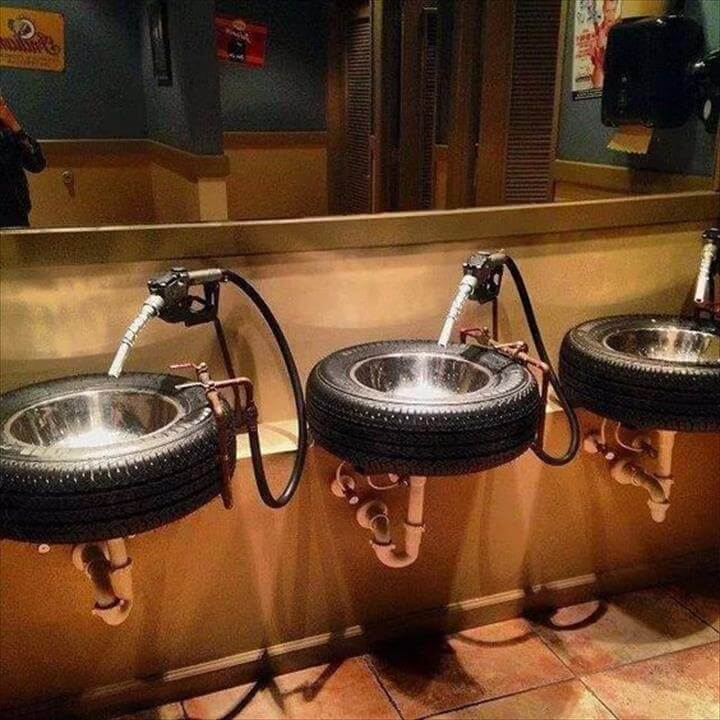 Repurposed old tires into sink, restroom bathroom sinks; gas pump handle for water;