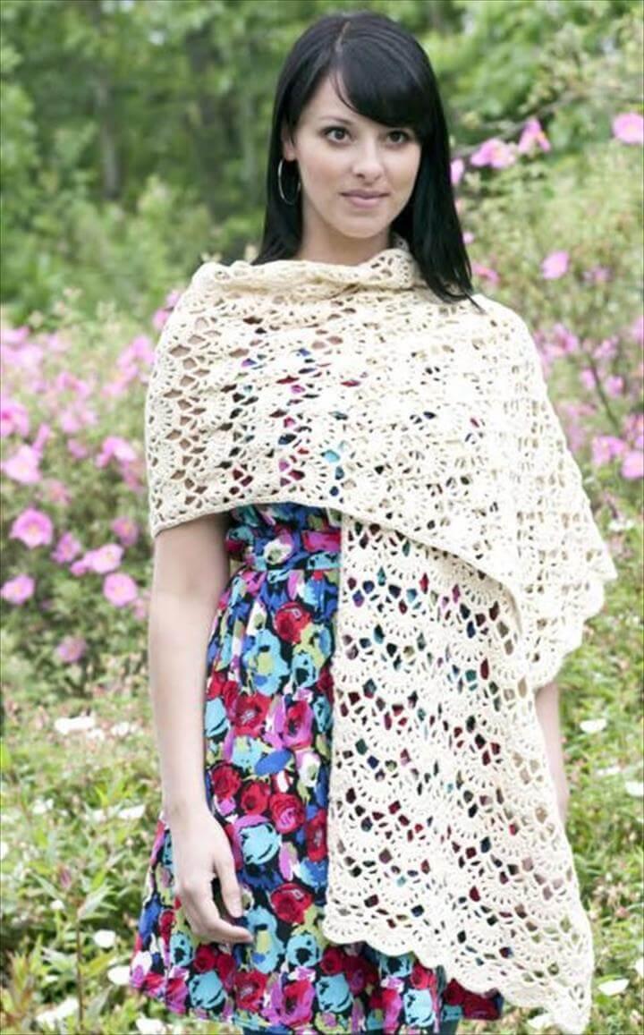 woman wearing a white crocheted shawl
